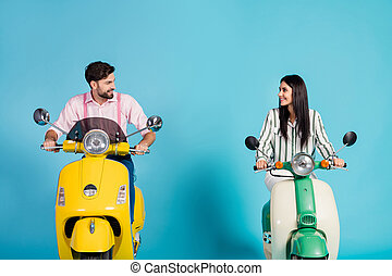 Positive cheerful lovely wife husband bikers drive choppers look enjoy motor bike way traveling wear striped pink formalwear shirt isolated over blue color background