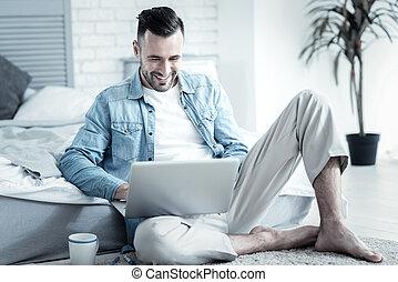 Positive cheerful man enjoying his job