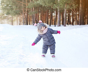 Positive child having fun in winter day