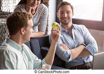 Positive colleagues having a conversation