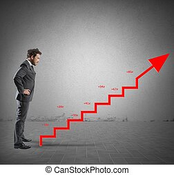 Businessman with positive company statistics like a stairs