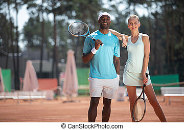 Positive couple are playing sport jointly outdoor - Full...