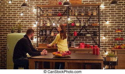 Positive couple spending leisure in the kitchen