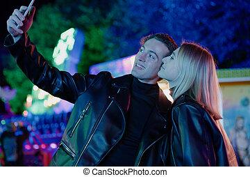 Positive Couple Take Selfie in Amusement Park