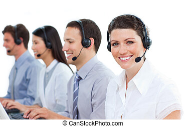 Positive customer service agents working in a call center ...