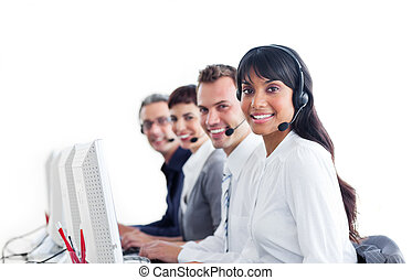 Positive customer service representatives with headset on in a call center