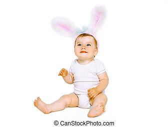 Positive cute baby in costume easter bunny