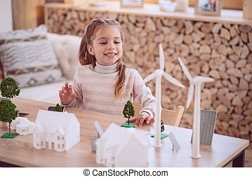 Positive cute girl playing at home