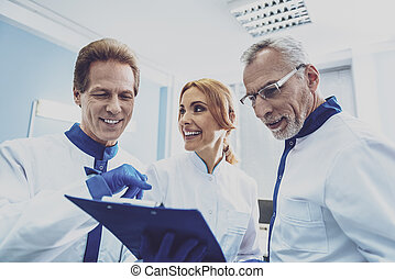 Positive delighted colleagues discussing results