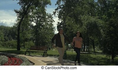 Positive delighted couple relaxing together in the park