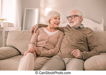 Positive delighted couple spending weekend at home