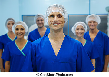 Positive delighted doctor standing on the foreground