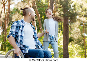 Positive delighted family spending time with pleasure