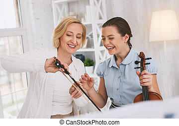 Positive delighted females spending lesson with pleasure