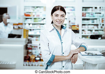 Positive delighted girl working in drug store
