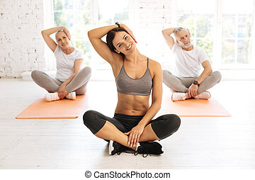 Positive delighted group of people while training