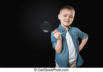 Positive delighted kid putting his left hand on the belt