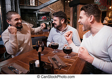 Positive delighted men expressing their emotions