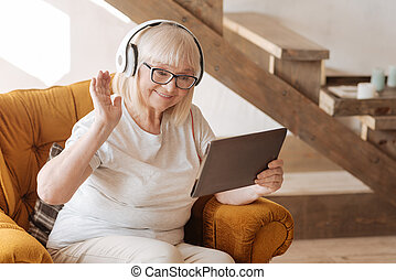 Positive delighted woman listening to music