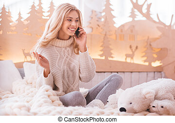 Positive delighted woman speaking on the phone