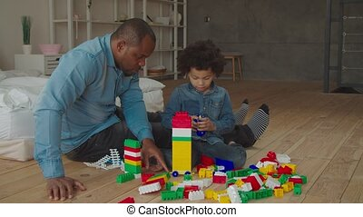 Positive diverse family enjoynig playtime at home