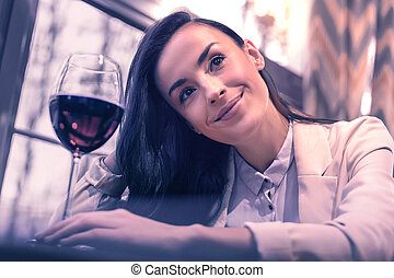 Positive dreamy young woman enjoying her day