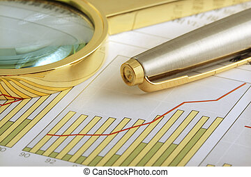 Positive Earning - A pen and a magnifying glass focusing on ...