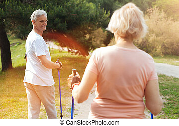 Positive elderly couple exercising together