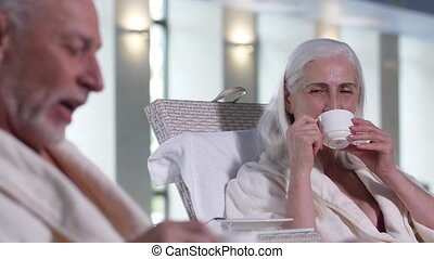 Positive elderly couple relaxing in spa hotel