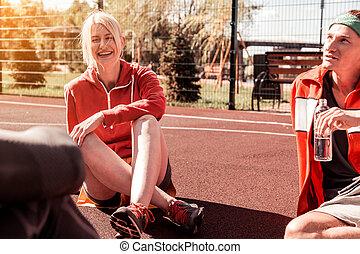 Joyful happy woman being in a great mood