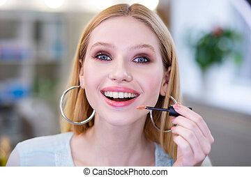 Portrait of a happy blonde woman smiling