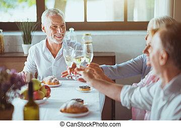 Positive family enjoying celebration at home.