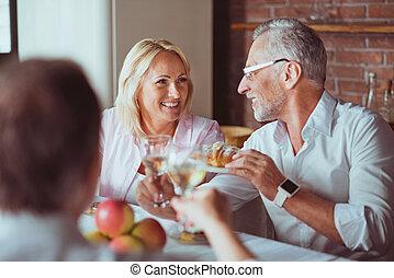 Positive family enjoying celebration