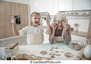 Positive family fooling around in kitchen
