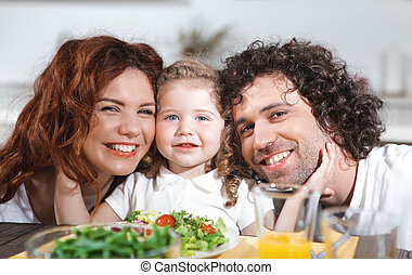 Positive family having healthy dinner with enjoyment