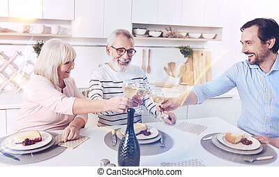Positive family meeting together in the kitchen