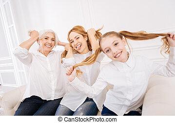 Positive family members having fun at home