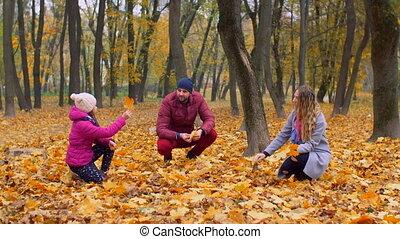 Positive family with girl enjoying fall season - Joyful...