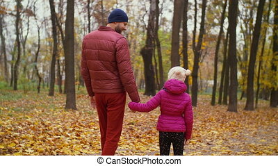 Positive father and daughter relaxing in autumn forest -...