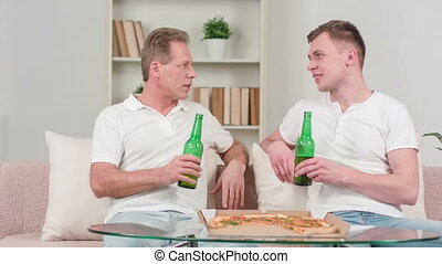 Positive father and son drinking beer