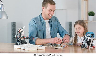 Positive father playing with his daughter