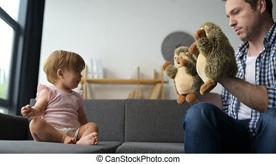 Positive father playing with his daughter at home