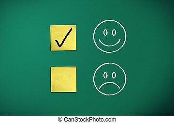 positive feedback rapresentated by emoticons on green chalk...