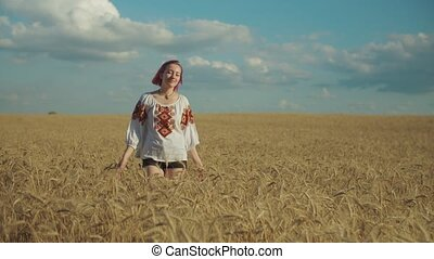 Positive female enjoying leisure in wheat field - Cheerful...