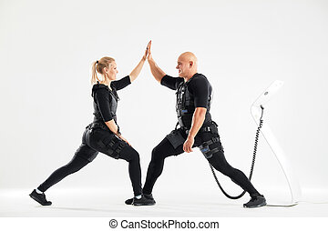 positive fit man and woman holding their hands