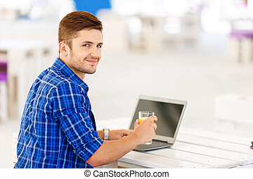 Positive freelancer working on the notebook