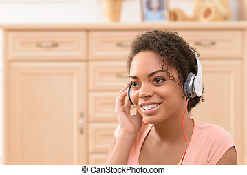 Positive girl listening to music - Feel the beat. Close up...