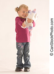 Positive girl with cuddly toy