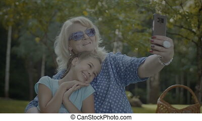 Positive grandmother making selfie with grandchild -...