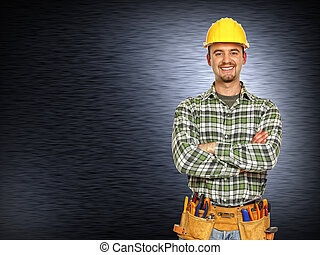 positive handyman smiling - caucasian manual worker and...